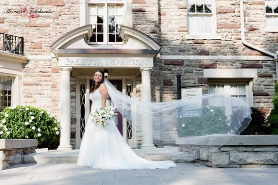 beautiful bride in front of the Paletta Mansion in Burlington