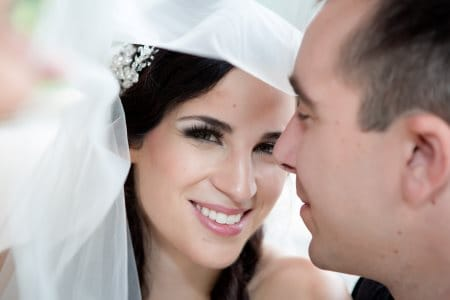 smiling bride with groom